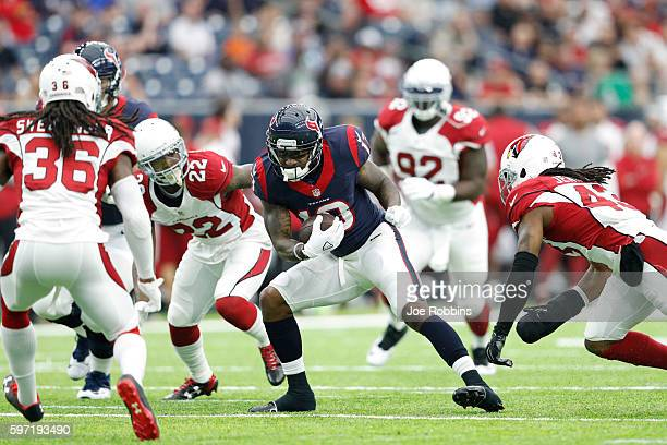 DeAndre Hopkins of the Houston Texans looks for room after a reception against the Arizona Cardinals in the first quarter of a preseason NFL game at...