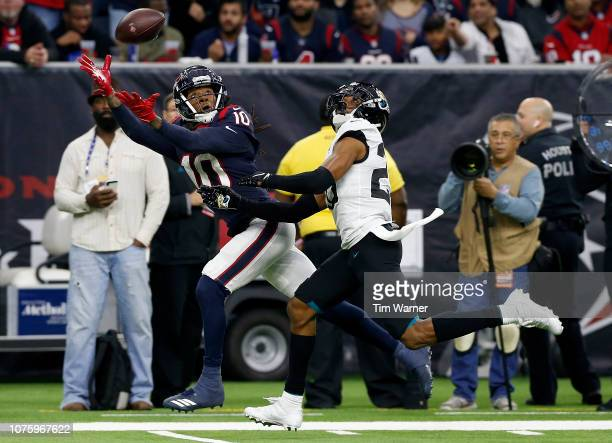 DeAndre Hopkins of the Houston Texans makes a catch defended by Jalen Ramsey of the Jacksonville Jaguars in the fourth quarter at NRG Stadium on...