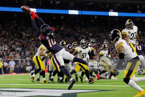 DeAndre Hopkins of the Houston Texans reaches for a pass on a two point conversion attempt defended by Joe Haden of the Pittsburgh Steelers in the...