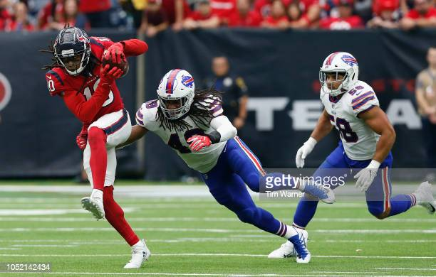 DeAndre Hopkins of the Houston Texans runs after a catch in the fourth quarter defended by Tremaine Edmunds of the Buffalo Bills at NRG Stadium on...