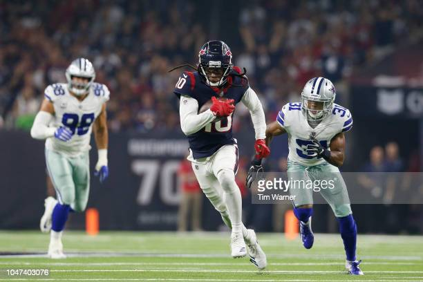 DeAndre Hopkins of the Houston Texans runs after a catch pursued by Byron Jones of the Dallas Cowboys in the first quarter at NRG Stadium on October...