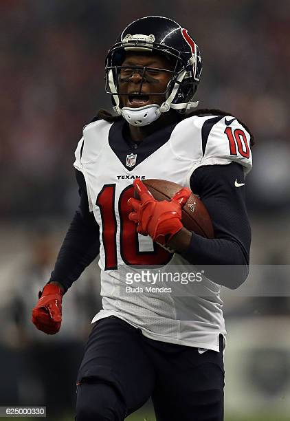 DeAndre Hopkins of the Houston Texans runs after catching a pass against the Oakland Raiders at Estadio Azteca on November 21 2016 in Mexico City...