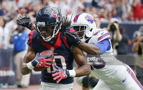 DeAndre Hopkins of the Houston Texans scores a second quarter touchdown in front of Corey Graham of the Buffalo Bills at NRG Stadium on September 28...