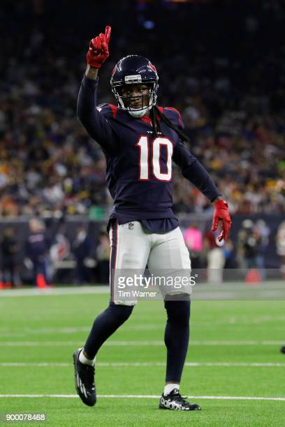 DeAndre Hopkins of the Houston Texans signals as he takes his position before a two point conversion attempt in the second half against the...