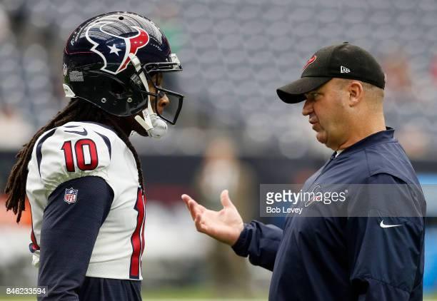 DeAndre Hopkins of the Houston Texans talks with head coach Bill O'Brien of the Houston Texans at NRG Stadium on September 10 2017 in Houston Texas