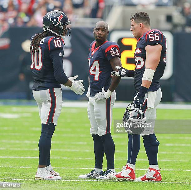 DeAndre Hopkins of the Houston Texans talks with Johnathan Joseph and Brian Cushing at NRG Stadium on October 2 2016 in Houston Texas