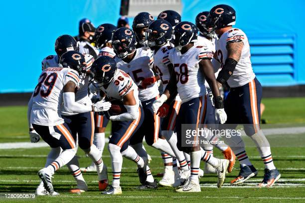 DeAndre HoustonCarson of the Chicago Bears celebrates with teammates after making an interception in the fourth quarter at Bank of America Stadium on...