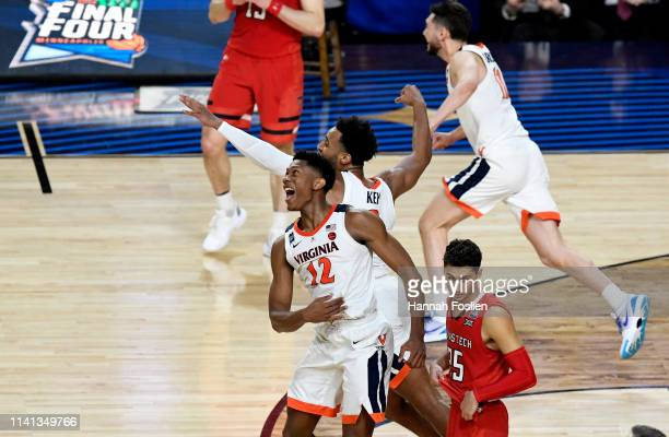 De'Andre Hunter and Braxton Key of the Virginia Cavaliers celebrate their teams 8577 win over the Texas Tech Red Raiders during the 2019 NCAA men's...
