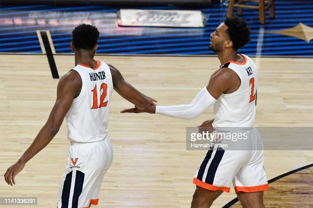 De'Andre Hunter and Braxton Key of the Virginia Cavaliers speak against the Texas Tech Red Raiders in the first half during the 2019 NCAA men's Final...