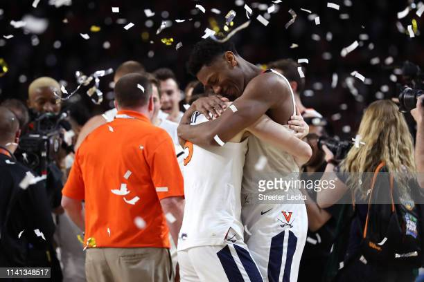 De'Andre Hunter and Kyle Guy of the Virginia Cavaliers celebrate their teams 8577 win over the Texas Tech Red Raiders to win the the 2019 NCAA men's...