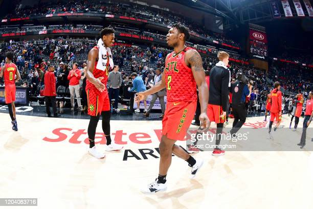 De'Andre Hunter and Treveon Graham of the Atlanta Hawks hifives each other after the game against the Brooklyn Nets on February 28 2020 at State Farm...
