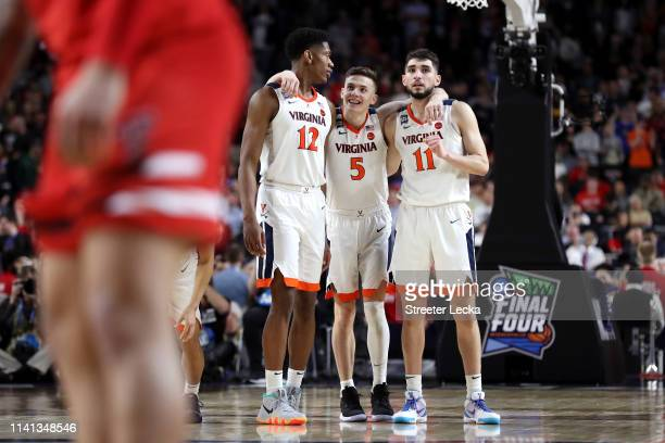 De'Andre Hunter Kyle Guy and Ty Jerome of the Virginia Cavaliers celebrate their teams lead late in overtime against the Texas Tech Red Raiders...
