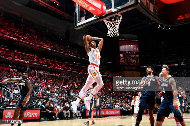 De'Andre Hunter of the Atlanta Hawks dunks the ball against the New Orleans Pelicans during a preseason game on October 7 2019 at State Farm Arena in...