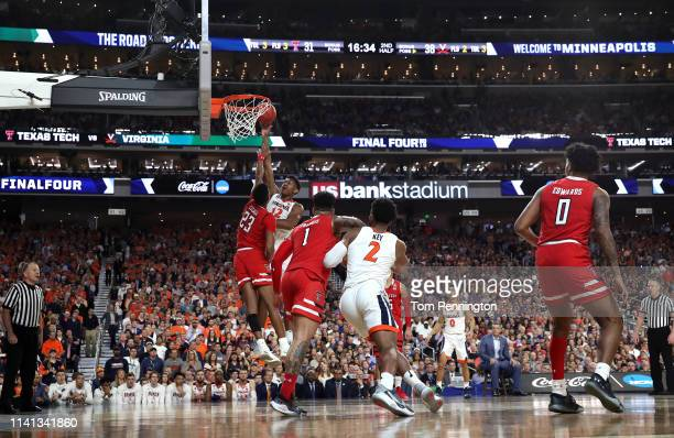 De'Andre Hunter of the Virginia Cavaliers attempts a shot against Jarrett Culver of the Texas Tech Red Raiders in the second half during the 2019...