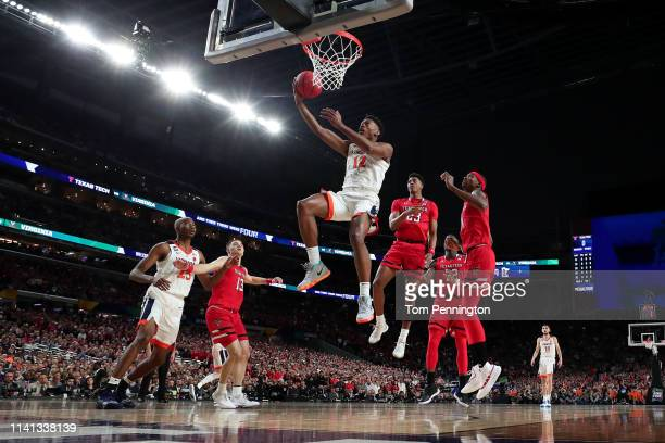 De'Andre Hunter of the Virginia Cavaliers attempts a shot against the Texas Tech Red Raiders in the first half during the 2019 NCAA men's Final Four...