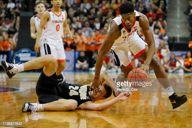 De'Andre Hunter of the Virginia Cavaliers battles for a loose ball with Grady Eifert of the Purdue Boilermakers during the first half of the 2019...