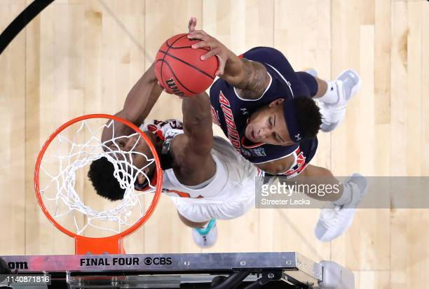 De'Andre Hunter of the Virginia Cavaliers blocks a dunk by Bryce Brown of the Auburn Tigers in the second half during the 2019 NCAA Final Four...