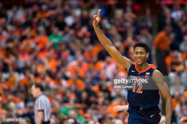 De'Andre Hunter of the Virginia Cavaliers celebrates a three point basket during the second half against the Syracuse Orange at the Carrier Dome on...