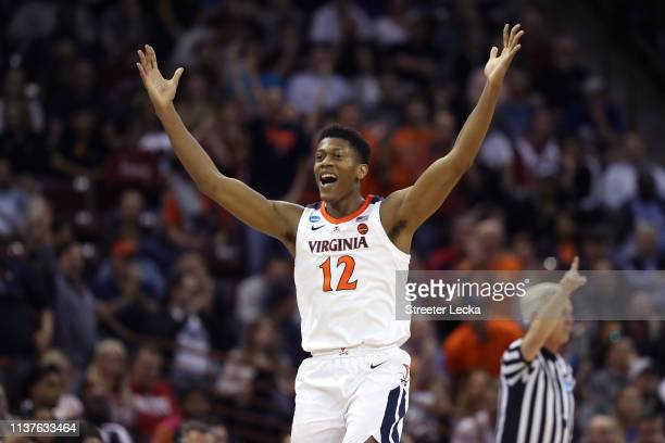 De'Andre Hunter of the Virginia Cavaliers celebrates after a play in the second half against the Gardner Webb Runnin Bulldogs during the first round...
