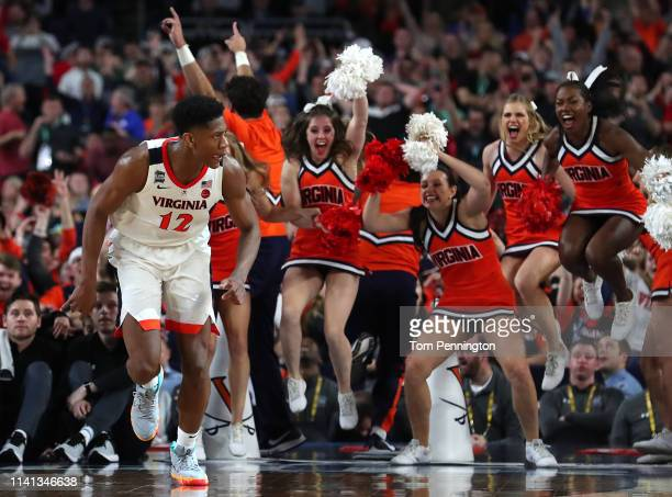 De'Andre Hunter of the Virginia Cavaliers celebrates his three point basket basket late in the second half against the Texas Tech Red Raiders during...