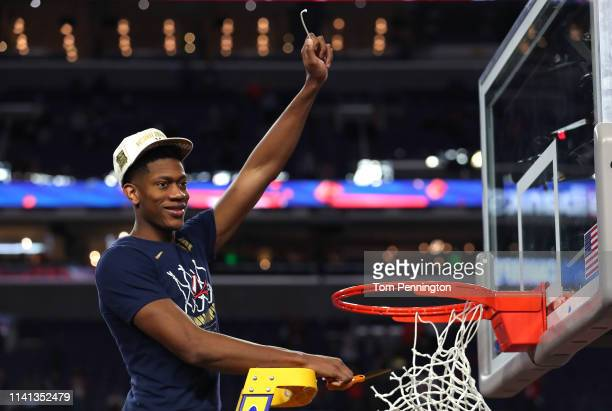 De'Andre Hunter of the Virginia Cavaliers cuts down the net after his teams 8577 win over the Texas Tech Red Raiders in the 2019 NCAA men's Final...