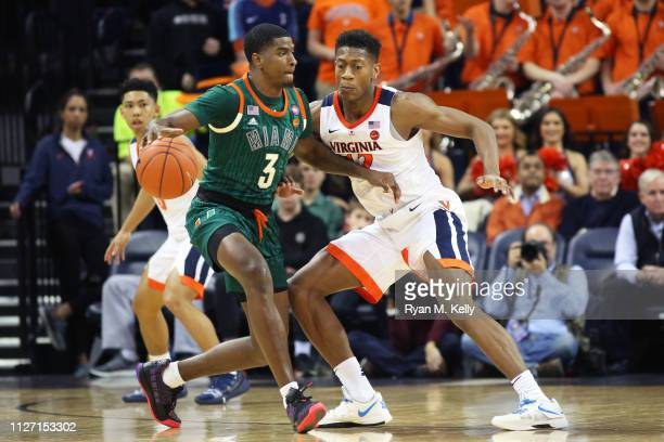 De'Andre Hunter of the Virginia Cavaliers defends Anthony Lawrence II of the Miami Hurricanes in the second half during a game at John Paul Jones...