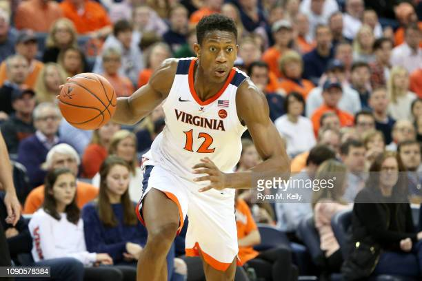 De'Andre Hunter of the Virginia Cavaliers dribbles in the second half during a game against the Florida State Seminoles at John Paul Jones Arena on...