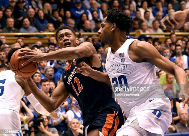 De'Andre Hunter of the Virginia Cavaliers drives against Marques Bolden of the Duke Blue Devils during the first half of their game at Cameron Indoor...
