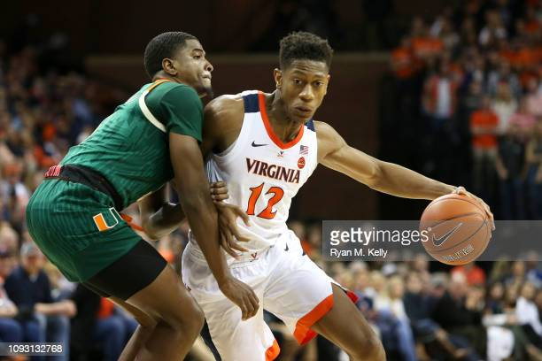 De'Andre Hunter of the Virginia Cavaliers drives past Anthony Lawrence II of the Miami Hurricanes in the second half during a game at John Paul Jones...