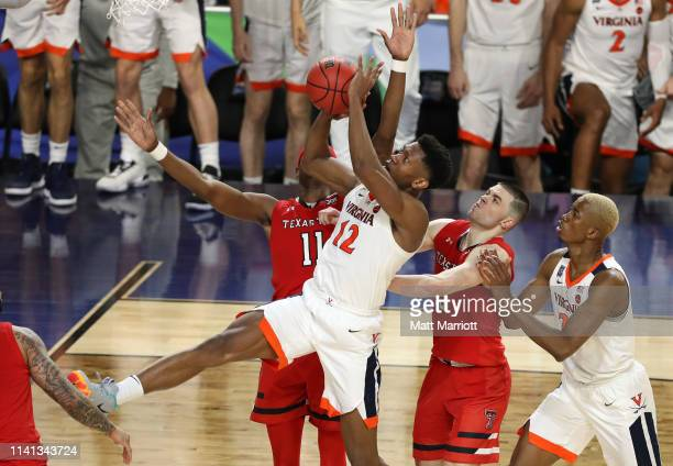 De'Andre Hunter of the Virginia Cavaliers drives to the basket against the Texas Tech Red Raiders during the second half of the 2019 NCAA men's Final...
