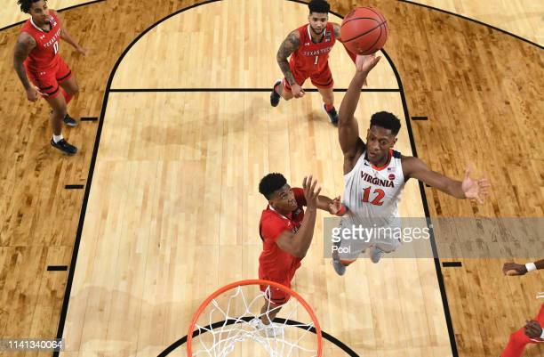 De'Andre Hunter of the Virginia Cavaliers dunks the ball against the Texas Tech Red Raiders in the first half during the 2019 NCAA men's Final Four...