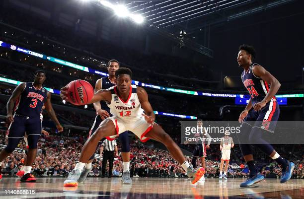 De'Andre Hunter of the Virginia Cavaliers handles the ball in the first half against the Auburn Tigers during the 2019 NCAA Final Four semifinal at...