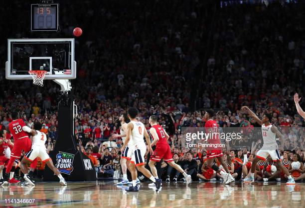 De'Andre Hunter of the Virginia Cavaliers hits a three point basket with 13 seconds left in the second half against the Texas Tech Red Raiders during...
