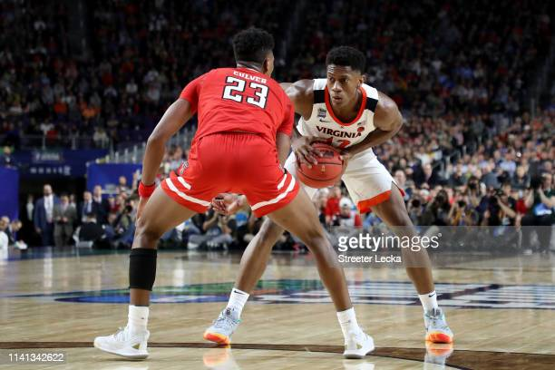 De'Andre Hunter of the Virginia Cavaliers is defended by Jarrett Culver of the Texas Tech Red Raiders in the second half during the 2019 NCAA men's...