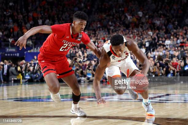 De'Andre Hunter of the Virginia Cavaliers is defended by Jarrett Culver of the Texas Tech Red Raiders during the 2019 NCAA men's Final Four National...