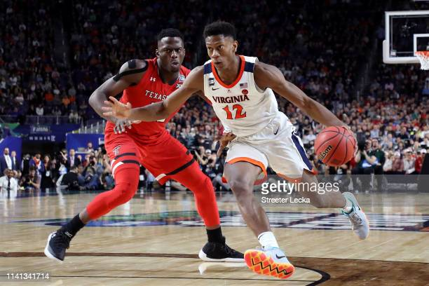 De'Andre Hunter of the Virginia Cavaliers is defended by Norense Odiase of the Texas Tech Red Raiders in the second half during the 2019 NCAA men's...