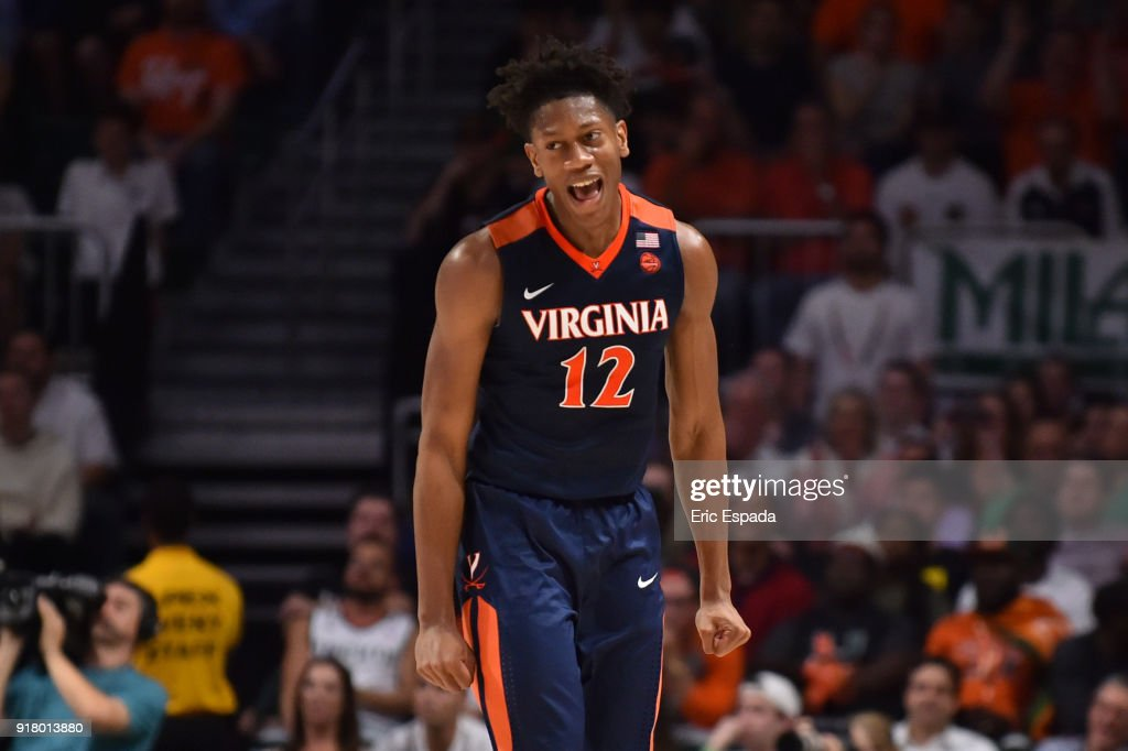 De'Andre Hunter #12 of the Virginia Cavaliers reacts after hitting a three pointer in the second half of the game against the Miami Hurricanes at The Watsco Center on February 13, 2018 in Miami, Florida.