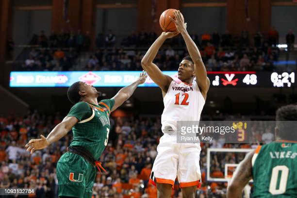 De'Andre Hunter of the Virginia Cavaliers shoots over Anthony Lawrence II of the Miami Hurricanes in the second half during a game at John Paul Jones...