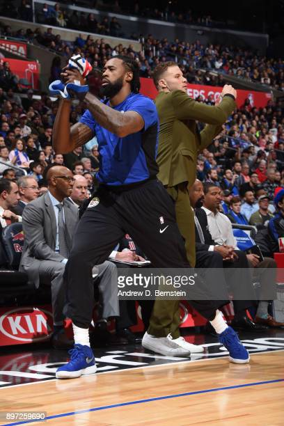 DeAndre Jordan and Blake Griffin of the LA Clippers celebrate from the bench during the game against the Phoenix Suns on December 20 2017 at STAPLES...