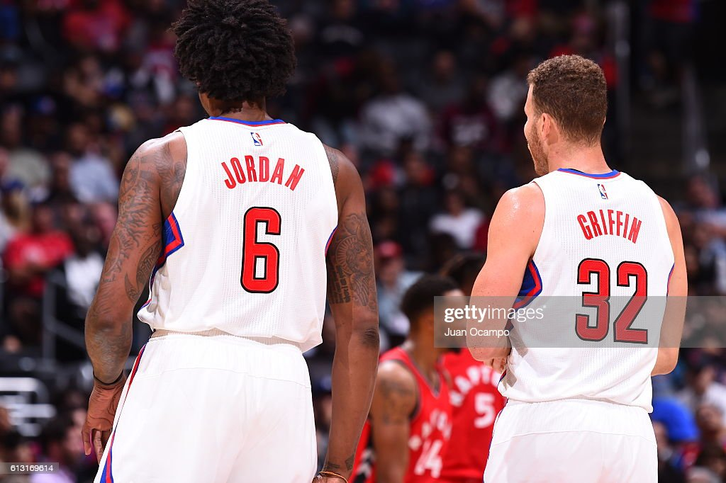 DeAndre Jordan #6 and Blake Griffin #32 of the Los Angeles Clippers look on during a game against the Toronto Raptors on October 5, 2016 at STAPLES Center in Los Angeles, California.