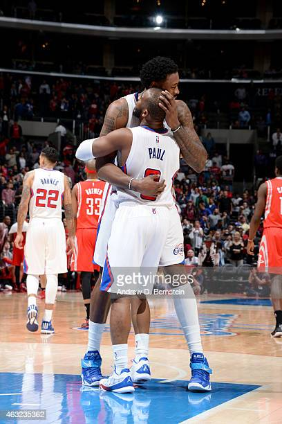DeAndre Jordan and Chris Paul of the Los Angeles Clippers celebrate a win after a game against the Houston Rockets on February 11 2015 at STAPLES...