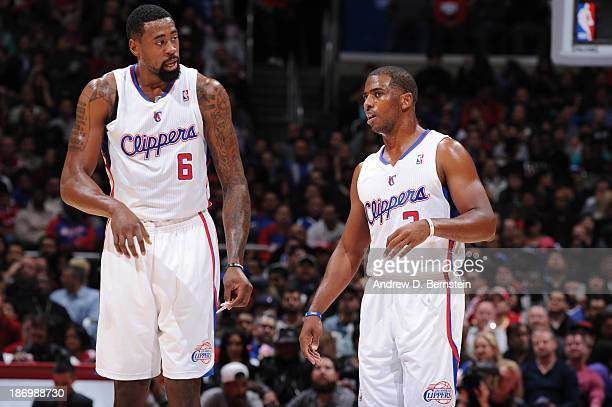 DeAndre Jordan and Chris Paul of the Los Angeles Clippers speak to each other on the court during their game against the Houston Rockets at Staples...