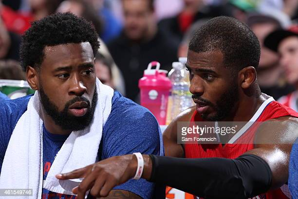 DeAndre Jordan and Chris Paul of the Los Angeles Clippers talk during the game against the Portland Trail Blazers on January 14 2015 at the Moda...