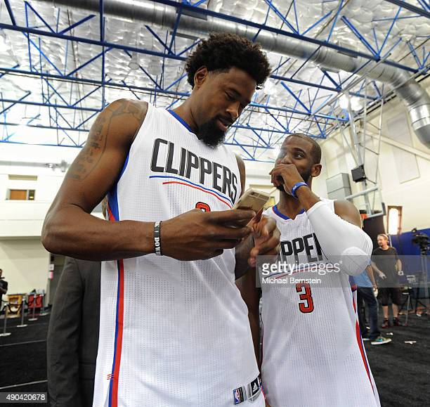 DeAndre Jordan and Chris Paul of the Los Angeles Clippers talk during media day at the Los Angeles Clippers Training Center on September 25 2015 in...