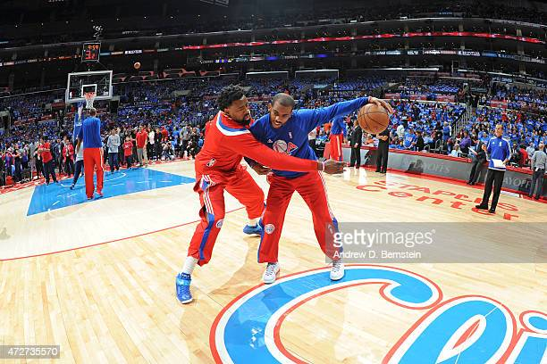 DeAndre Jordan and Chris Paul of the Los Angeles Clippers warm up before Game Three of the Western Conference Semifinals against the Houston Rockets...