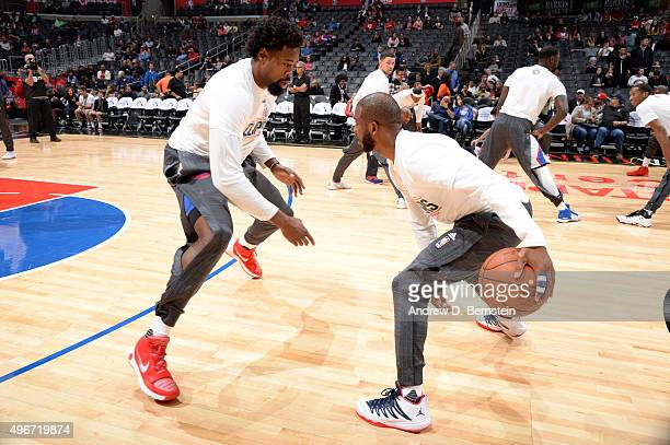 DeAndre Jordan and Chris Paul of the Los Angeles Clippers warm up before the game against the Memphis Grizzlies at STAPLES Center on November 09 2015...