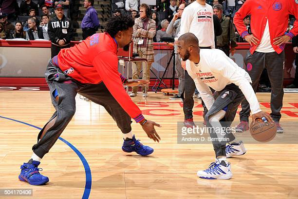 DeAndre Jordan and Chris Paul of the Los Angeles Clippers warms up before the game against the Charlotte Hornets on January 9 2016 at STAPLES Center...