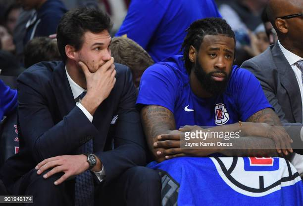 DeAndre Jordan and Danilo Gallinari of the Los Angeles Clippers look on from the bench in the fourth quarter of the game against the Golden State...