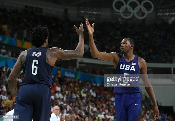 DeAndre Jordan and Kevin Durant of United States celebrate a play against Spain during the Men's Semifinal match on Day 14 of the Rio 2016 Olympic...