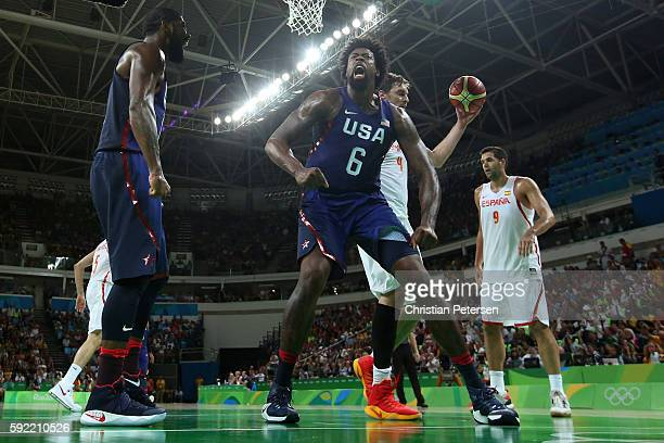 DeAndre Jordan and Kyrie Irving of United States celebrate a Jordan dunk as Pau Gasol and Felipe Reyes of Spain look on during the Men's Semifinal...